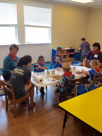 "Our youngest class led by Lynn Smith ""gets into"" painting in the Crafts Room"
