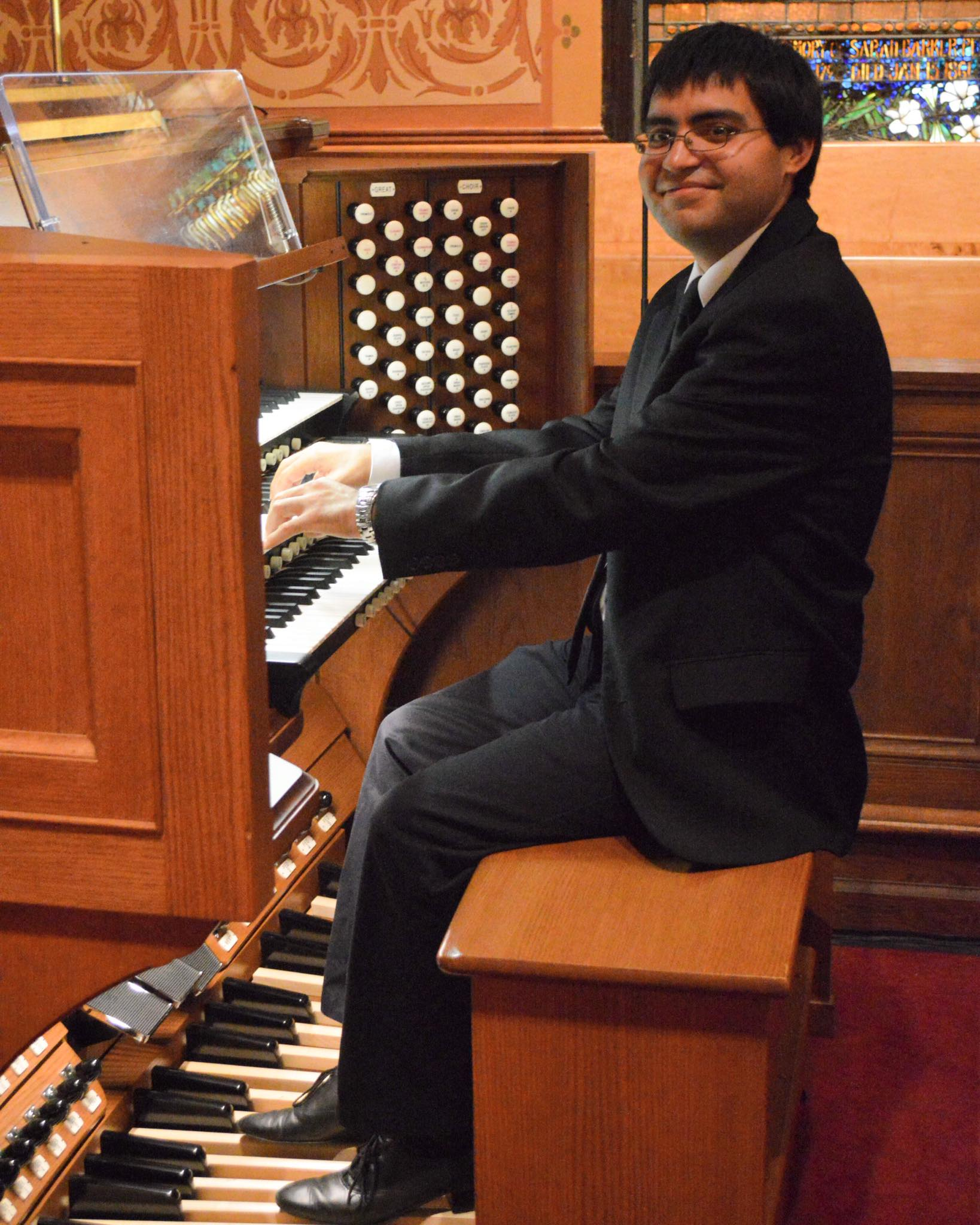 Photo of Director of Music Ministry, Ruben Rincon, Jr. seated at the organ.